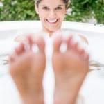 Beautiful woman taking a bath — Stock Photo