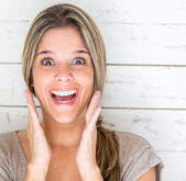 Excited woman looking surprised — Stok fotoğraf