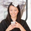 Woman at the hairdresser - Stock Photo