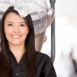 Woman dyeing her hair - Stock Photo