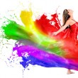 Woman dress turning into color paint - Stock Photo