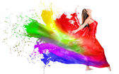 Woman dress turning into color paint — Stock Photo