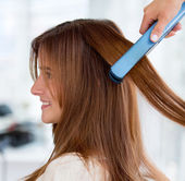 Straightening hair — Stock Photo