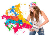 Woman splashing colorful paint — Stock fotografie