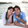 Happy couple in a yacht — Stock Photo
