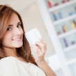 Woman holding moisturizing cream - Stock Photo