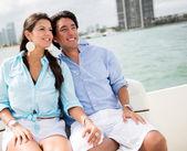 Romantic couple in a boat — Stock Photo