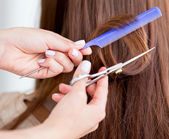 Cutting split ends of the hair — Stock Photo