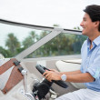 Man driving a yacht - Stock Photo