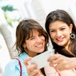 Girls texting from phone — Stock Photo #24217091