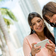 Happy women with a mobile phone — Stock Photo