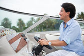 Man driving a yacht — Stock Photo