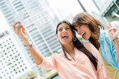 Girls taking a picture — Stock Photo