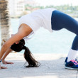 Stock Photo: Fit woman stretching outdoors