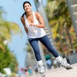 Woman skating outdoors — Stock Photo