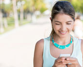 Woman texting on her phone — Foto Stock