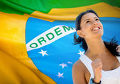 Woman running a marathon in Brazil — Stock Photo