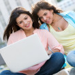 Girls social networking on a laptop — Stock Photo