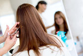 Woman cutting her hair — Stock Photo