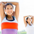 Women doing stretching exercises — Stock Photo #24469943