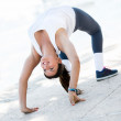 Stock Photo: Flexible woman stretching back