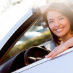 Woman driving a car — Stock Photo