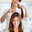 Girl getting a haircut — Stock Photo