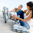 Female skaters outdoors - Stock Photo