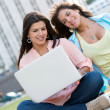 Women with a laptop outdoors — Stock Photo