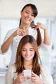 Girl getting a haircut — Stock Photo