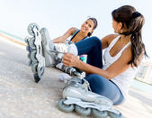 Female skaters outdoors — Stock Photo