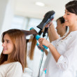 Stylist drying hair — Stok fotoğraf