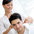 Man getting a haircut - Stock Photo