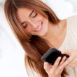 Woman texting from her phone — Stock Photo #24502485
