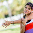 Fit woman stretching arm — Stock Photo