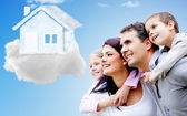 Family thinking of their dream house — Stock Photo