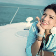 Thoughtful woman in a yacht — Stock Photo