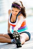 Woman doing stretches exercises — Stock Photo