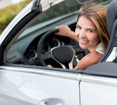 Woman renting a car — Stock Photo