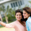 Women taking a picture with the phone — Stock Photo