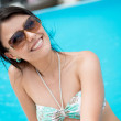 Happy woman by the swiming pool - Stockfoto