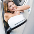 Stock Photo: Woman daydreaming in a car