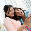 Girls using app on smart phone — Stock Photo