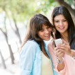 Women using a smart phone — Stock Photo