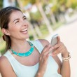 Happy woman with a cell phone — Stock Photo