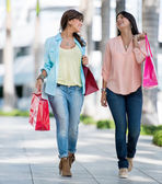 Women on a shopping spree — Stock Photo