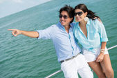 Couple pointing away in a yacht — Stock Photo