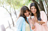 Women using a smart phone — Stok fotoğraf