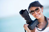 Female photographer — Stockfoto
