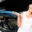 Woman with broken car - Stock Photo